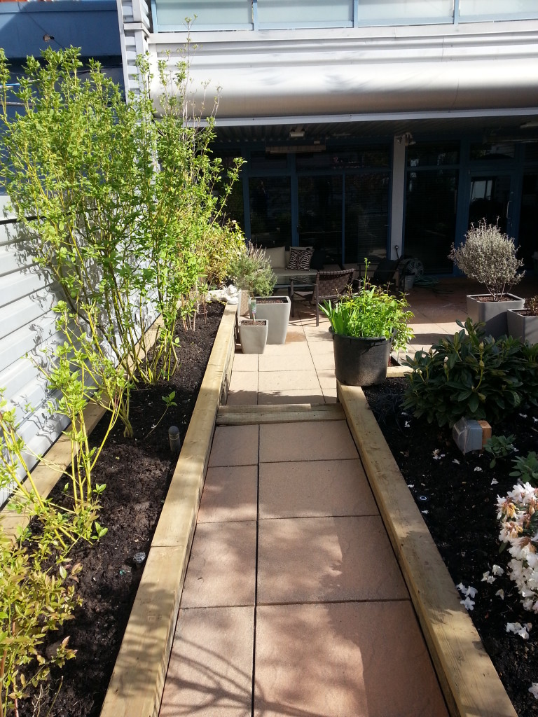 Brushed steel aluminum bulk heads and garden foot paths restored after SPM service